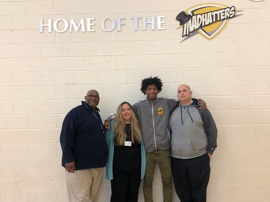 Thomas Blair, Amy Rudolph, Rayvon Griffith and Steve Stanley pose at Oyler School.