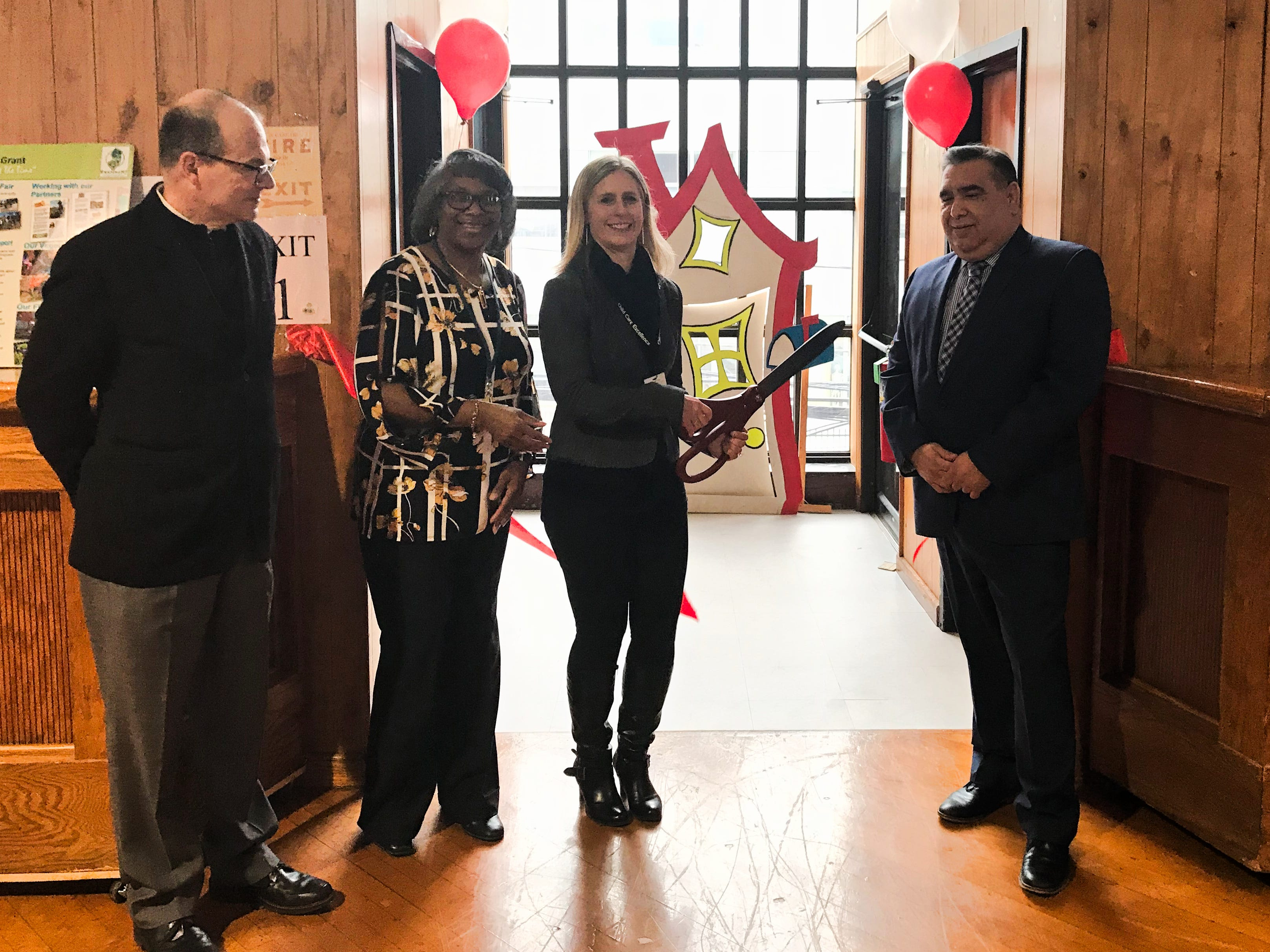 Left to Right, Reverend Monsignor Joseph Kerrigan joins Catholic Charities Child Care Center Director Cheryl Curry, Service Area Director Krista Glynn, and Acting Associate Director Julio Coto in a ceremonial Ribbon Cutting at the Youth Enrichment Services (YES)  Center at St Ladislaus, which opened its doors to students just in time for the 2018-2019 School Year. The Preschool Center at 197 Somerset St. has 12 classrooms with a maximum capacity of 180 preschoolers and is operated by Catholic Charities, Diocese of Metuchen.