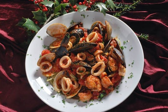 Zuppa di pesce with calamari, mussels and clams tossed over linguini in a red sauce is part of the Feast of the Seven Fishes on Christmas Eve at Mulberry Street in Woodbridge.