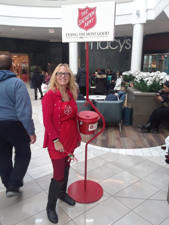 Dawn Van de Wiele and her husband, Daniel, say they encounter so many people while volunteering each year as bell ringers for the Salvation Army. Last year, a quarter of men gathered around and began singing songs.
