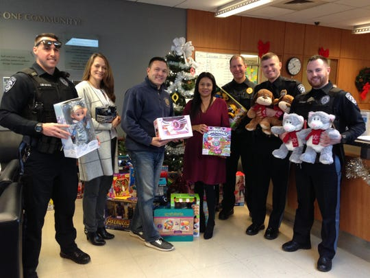 Santa sent his elves from the Bernardsville Township PBA #357 to Somerset Hills YMCA in the Basking Ridge section of Bernards to deliver more than 100 toys to children in the Y's Financial Assistance program. The toys were collected by members of the PBA, local police and their families. They will be given to children who are part of the Y's Financial Assistance program. The toy drive helps support this year's Giving Tree program at the Y. Each year, the Y collects gifts for families who receive financial assistance and may not otherwise be able to fulfill their basic necessities or Christmas wish-lists. Visit www.somersetcountyymca.org. (Left to right) Officer Ryan Caparoni; Somerset Hills YMCA Branch Executive Director Cheryl Tuturice; Bernardsville Township PBA #357 President Raymond Gizienski; Somerset Hills YMCA Financial Assistance Coordinator Beatriz Dominguez; Sgt. Keven Little; Lt. Scott Ward; and Officer John Mulhall. The group is pictured in front of the Giving Tree at Somerset Hills YMCA with toys donated by PBA members and their families.