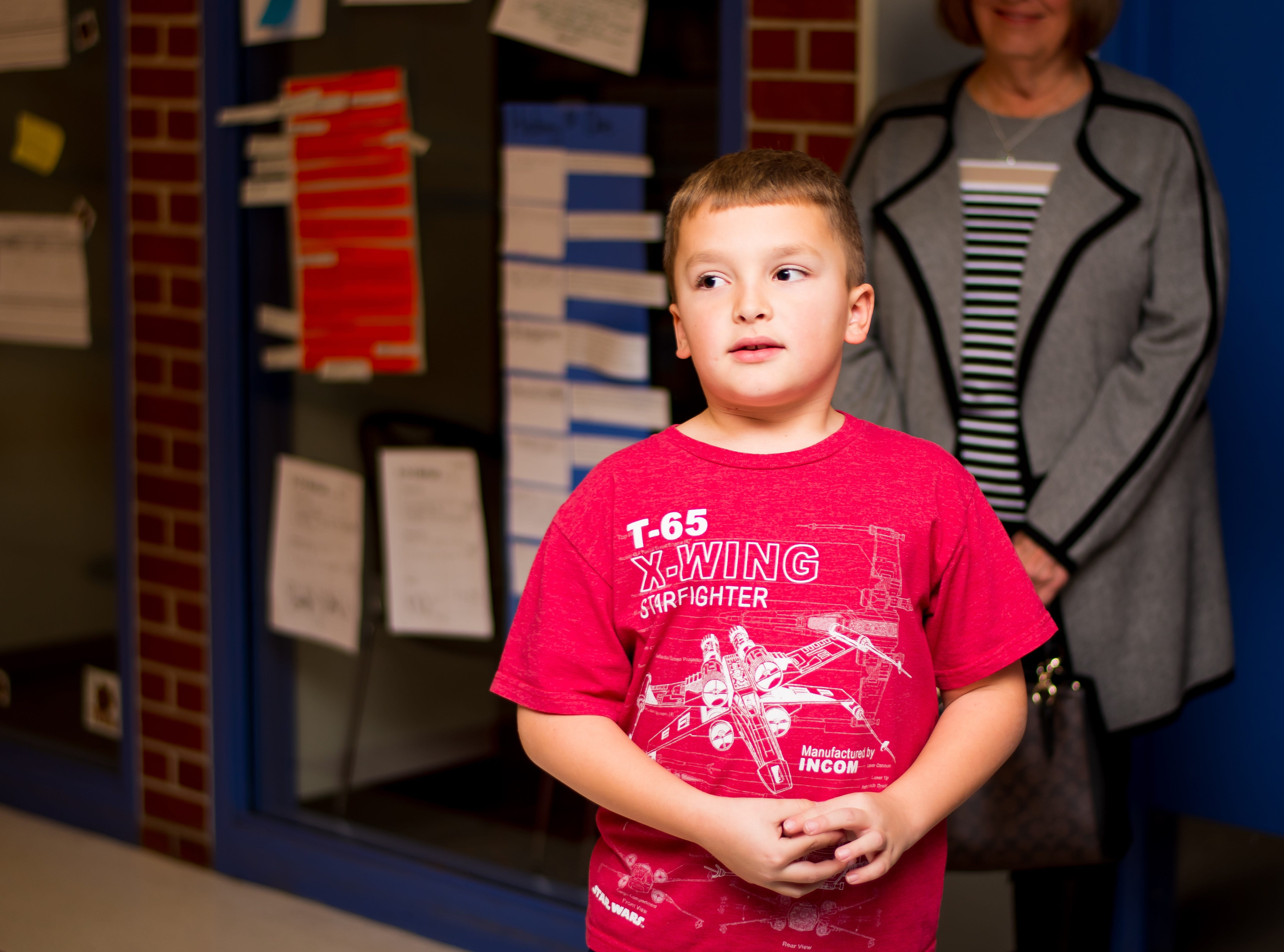 Matthew Bileau, 8, of Clive starts the Celebrate Crestview event off with a game of rock, paper, scissors on Tuesday, Dec. 11, 2018 at Crestview School of Inquiry in Clive. Students learned the history of immigration in Clive and the impact it has had on Crestview.
