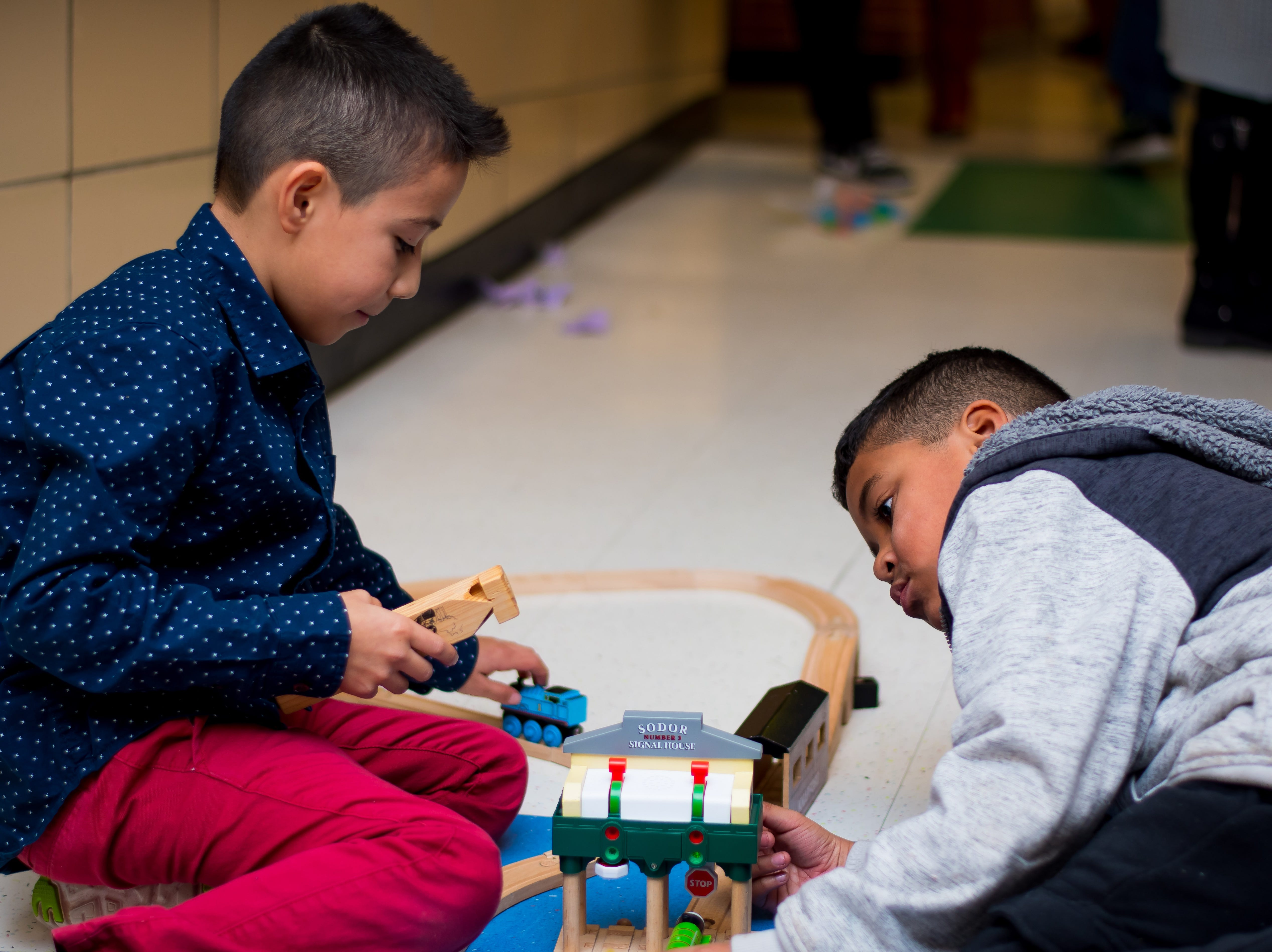 Fredy Mondragon, 8, and Abel Bustos-Bracamonte, 9, both of Clive set up trains for their part of the Celebrate Crestview event on Tuesday, Dec. 11, 2018 at Crestview School of Inquiry in Clive. Students learned the history of immigration in Clive and the impact it has had on Crestview.