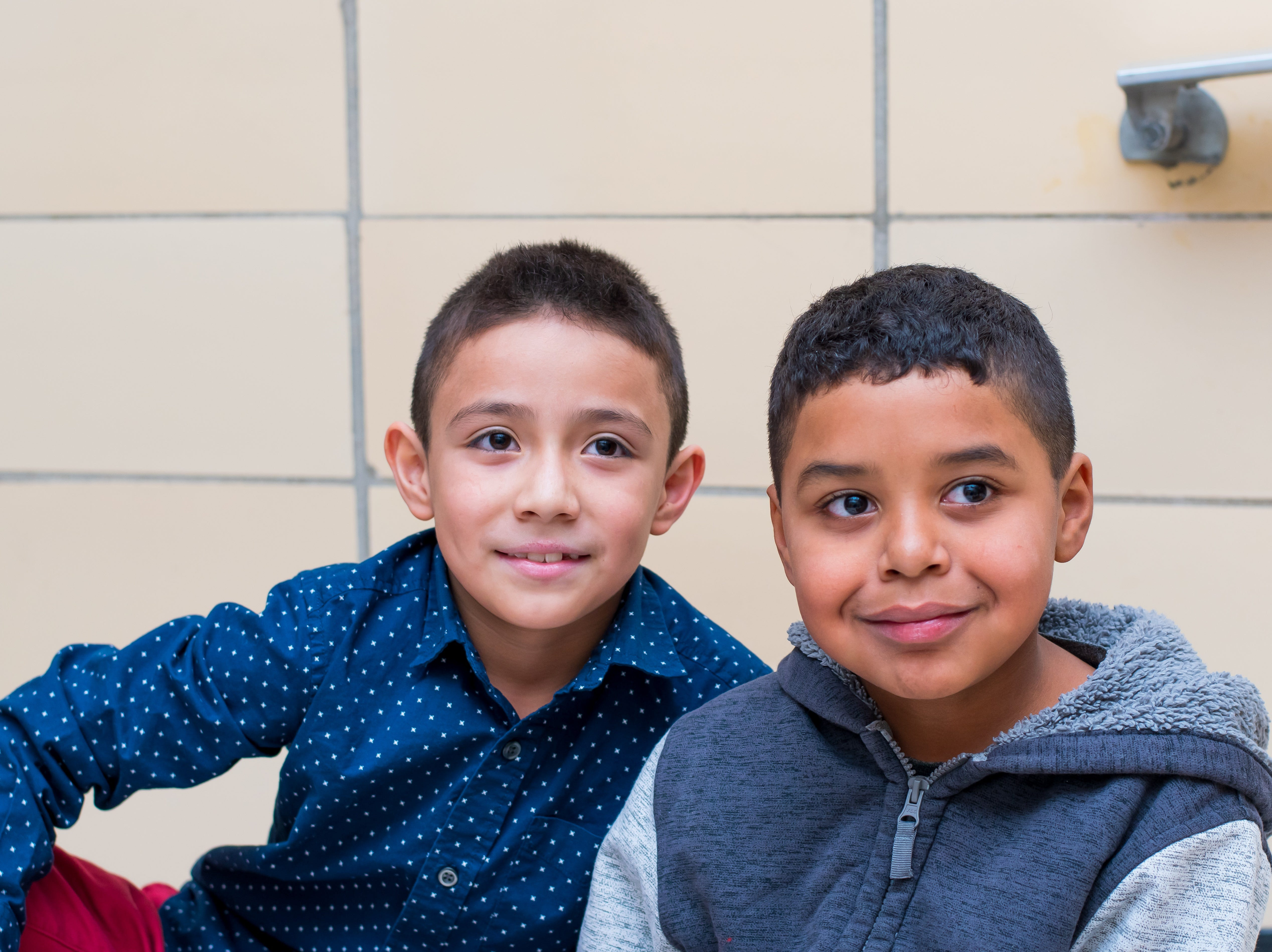 Fredy Mondragon, 8, and Abel Bustos-Bracamonte, 9, both of Clive take a break at the Celebrate Crestview event on Tuesday, Dec. 11, 2018 at Crestview School of Inquiry in Clive. Students learned the history of immigration in Clive and the impact it has had on Crestview.