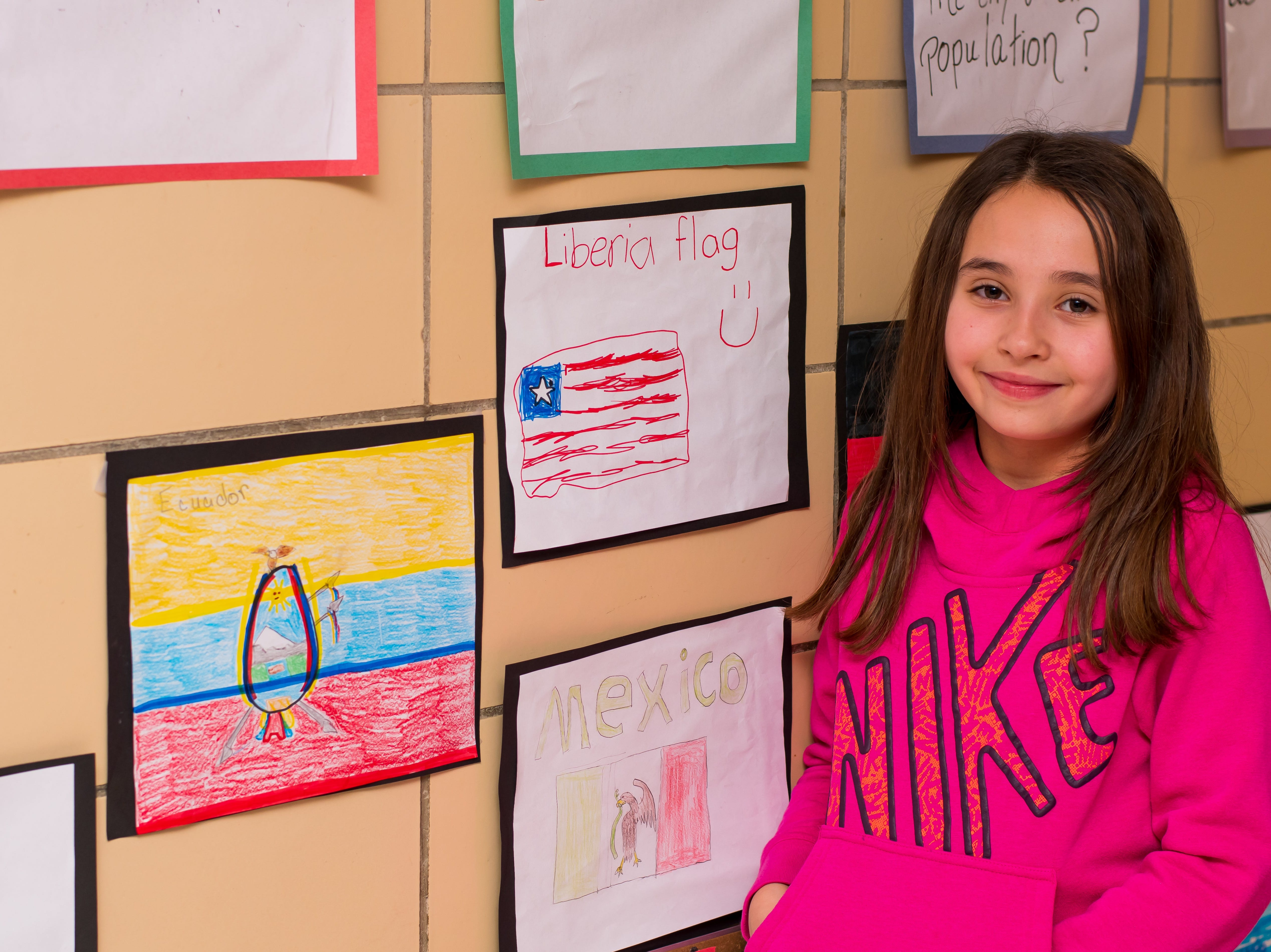 Leila Hidic, 9, of Clive shares her work at the Celebrate Crestview event on Tuesday, Dec. 11, 2018 at Crestview School of Inquiry in Clive. Students learned the history of immigration in Clive and the impact it has had on Crestview.