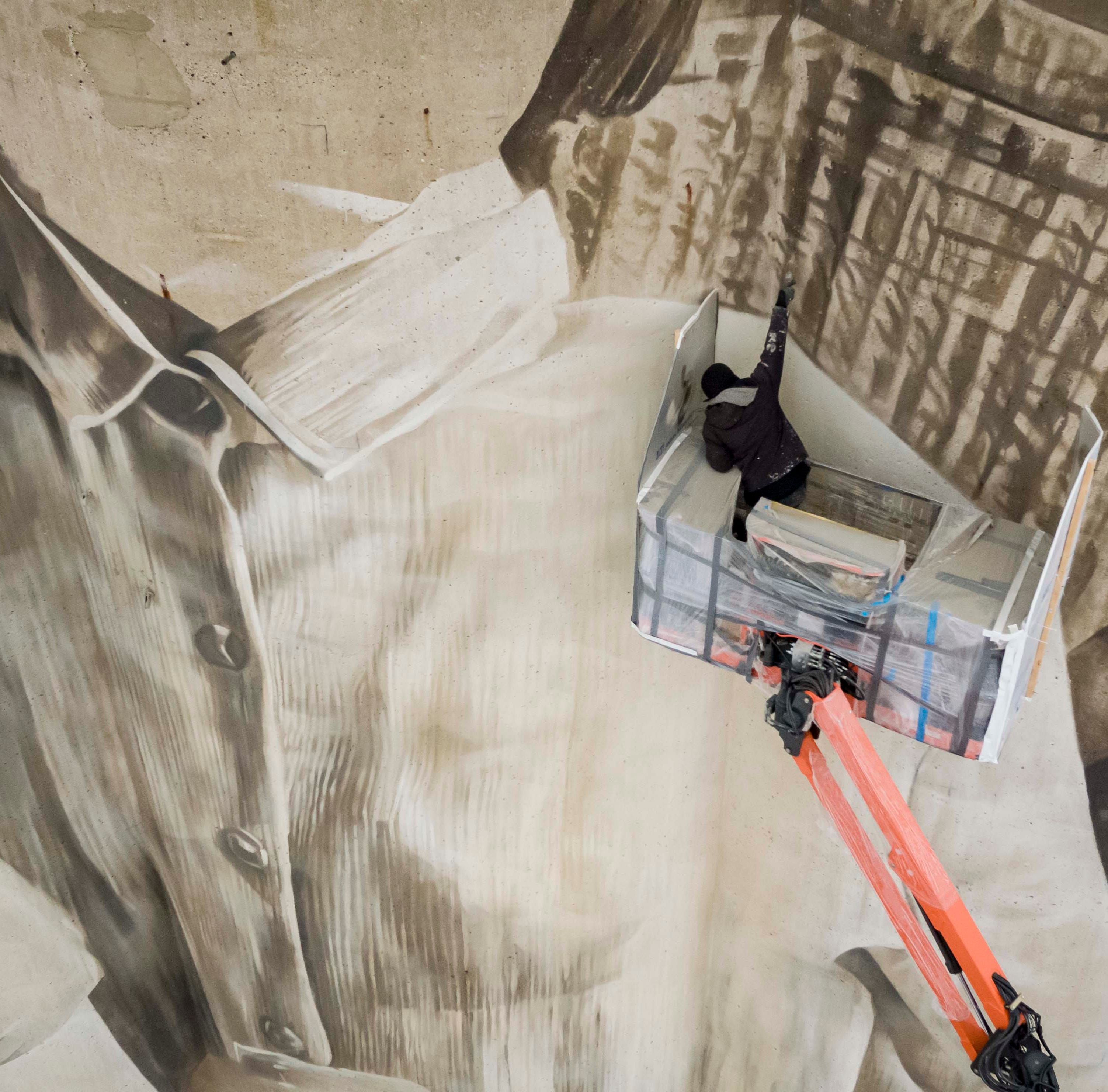 Using a 110-foot silo as his canvas, Australian artist creates Iowa's largest mural