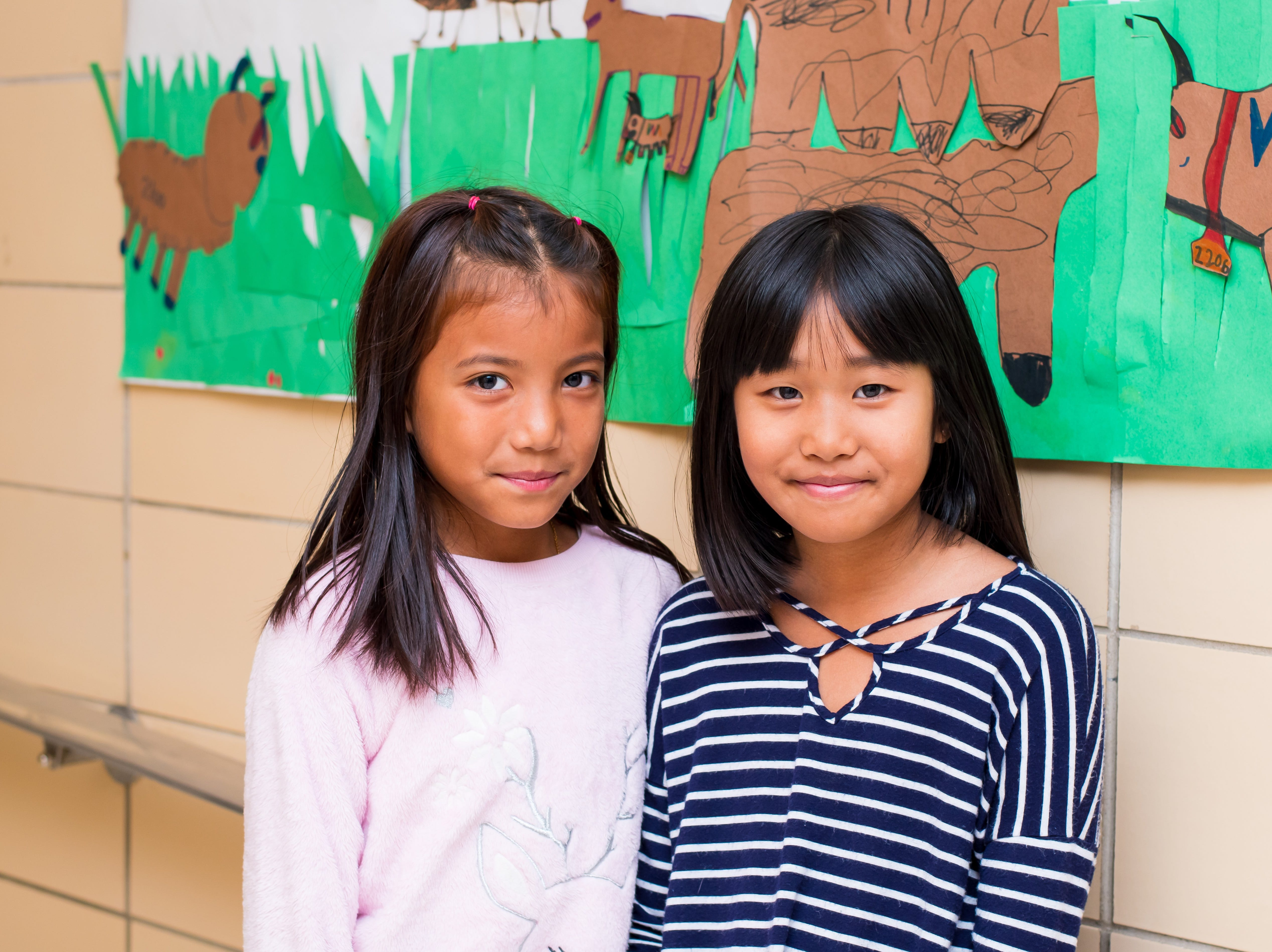 Nguntin Thluai, 9, and Esther Par, 9, both of Clive are ready to read their parts at the Celebrate Crestview event on Tuesday, Dec. 11, 2018 at Crestview School of Inquiry in Clive. Students learned the history of immigration in Clive and the impact it has had on Crestview.