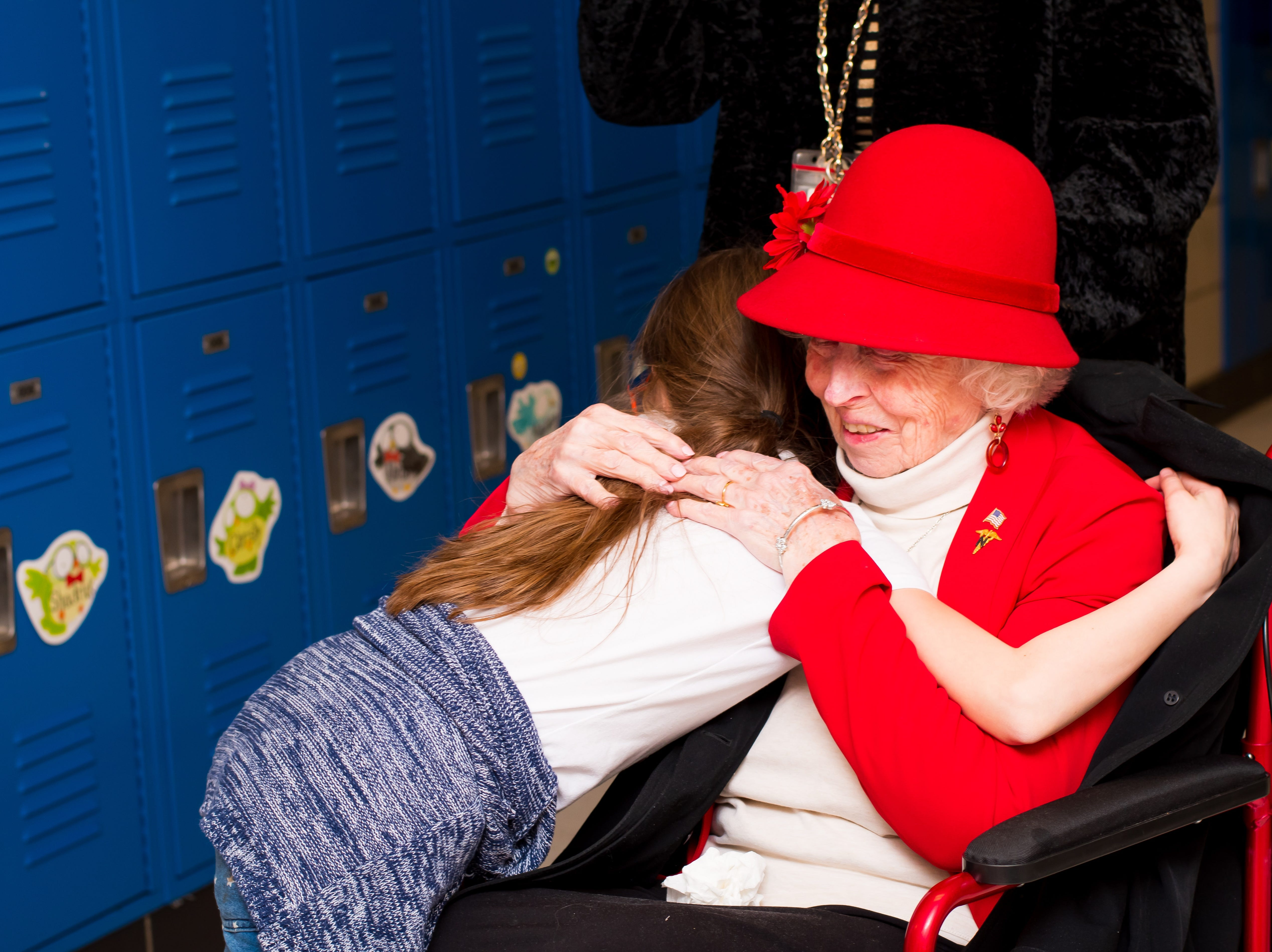 Amelia Lee, 9, of Clive greets WWII veteran Elaine Hamilton at the Celebrate Crestview event on Tuesday, Dec. 11, 2018 at Crestview School of Inquiry in Clive. Students learned the history of immigration in Clive and the impact it has had on Crestview.