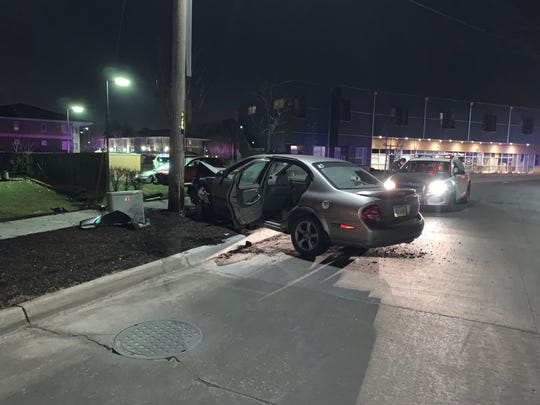 A Nissan Maxima crashed into this utility pole just south of downtown Des Moines on Wednesday, Dec. 12, 2018. The car was being chased by another and shots were fired, police said. The rear window appears to have been struck by bullets, but no injures have been reported.