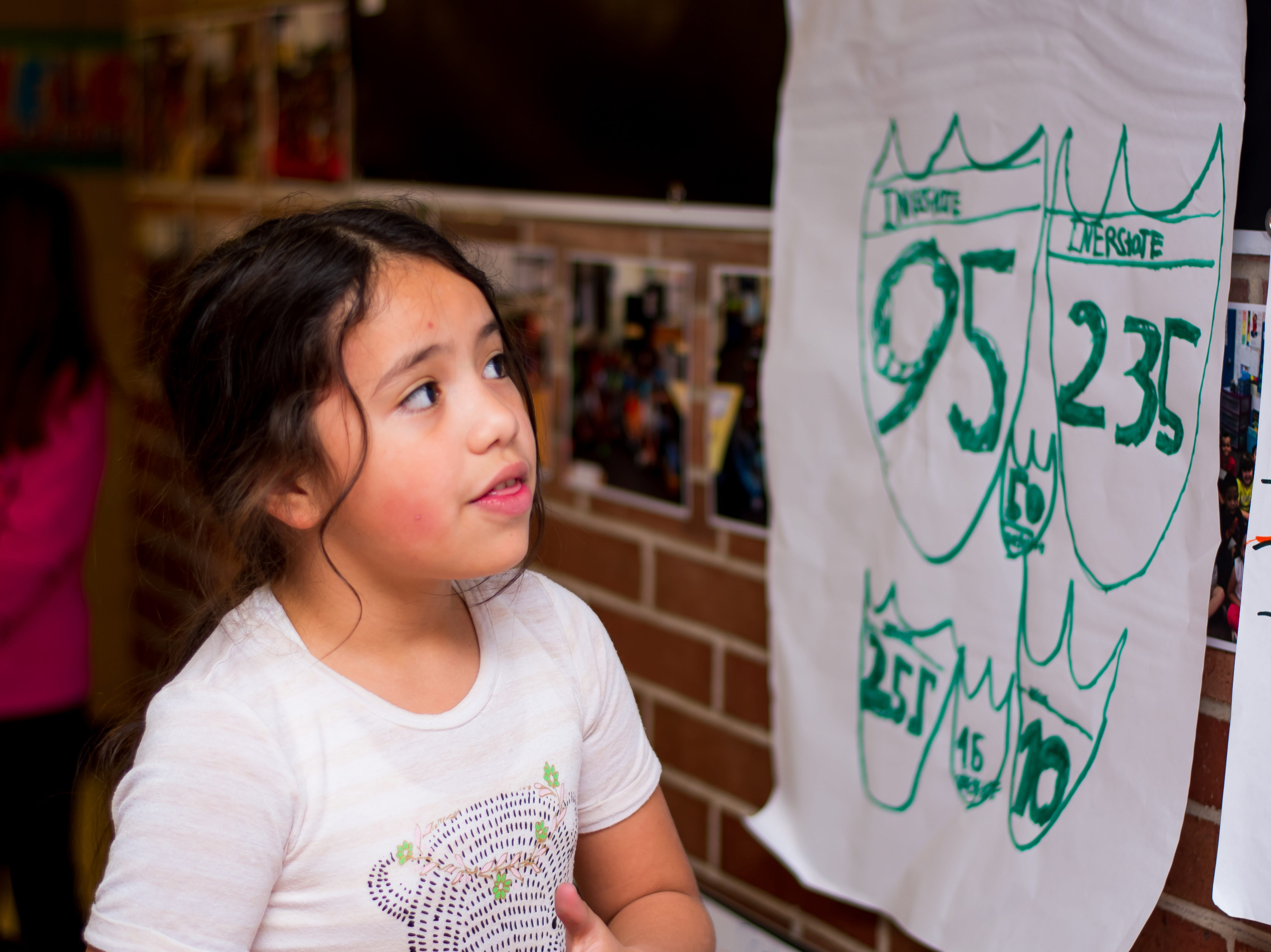 Smiley Rogdegez, 8, of Clive shares her work at the Celebrate Crestview event on Tuesday, Dec. 11, 2018 at Crestview School of Inquiry in Clive. Students learned the history of immigration in Clive and the impact it has had on Crestview.
