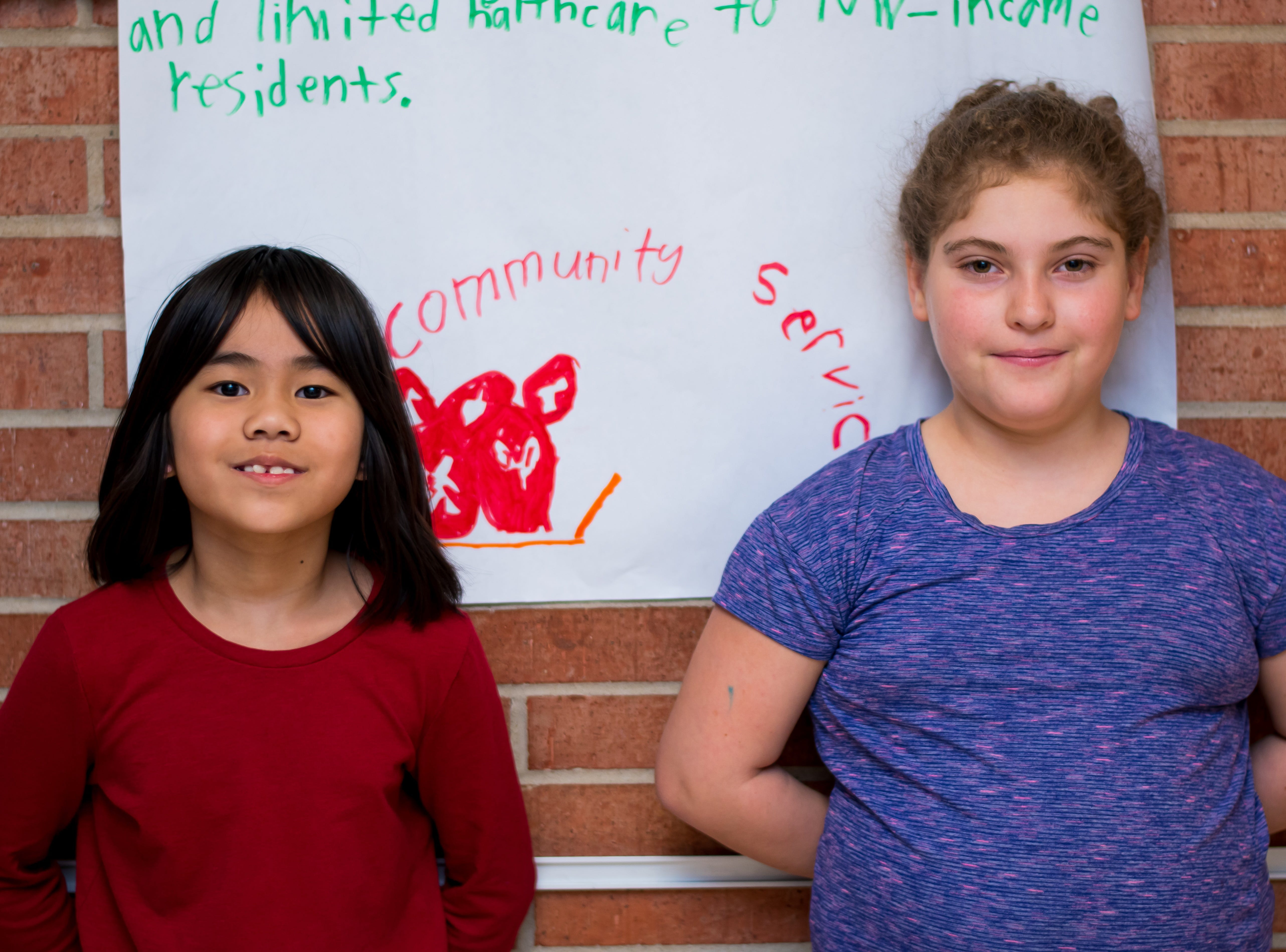 Linda Da, 8, and Maddy Sanchez, 9, both of Clive are ready to read their parts at the Celebrate Crestview event on Tuesday, Dec. 11, 2018 at Crestview School of Inquiry in Clive. Students learned the history of immigration in Clive and the impact it has had on Crestview.