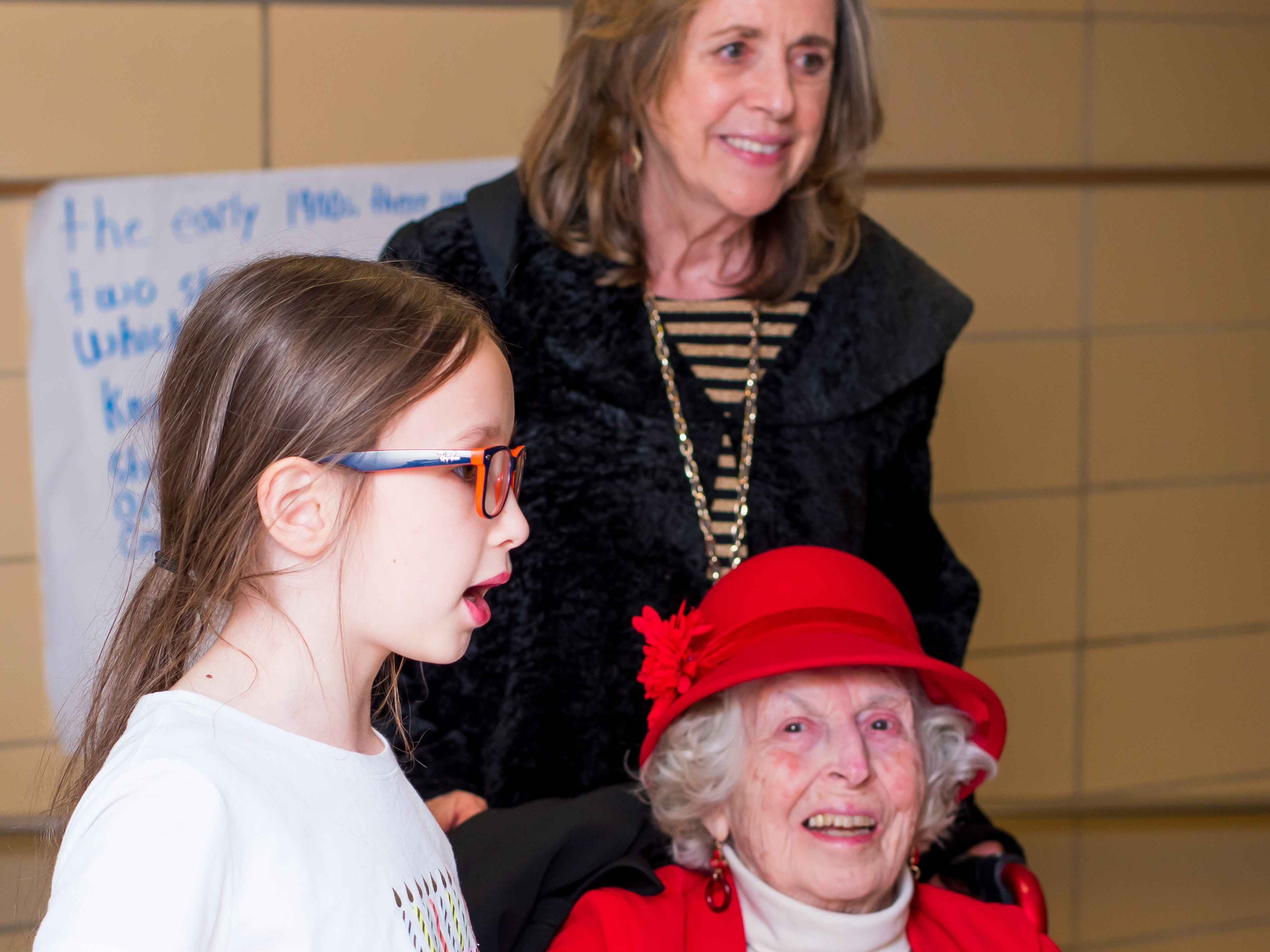 Amelia Lee, 9, of Clive takes WWII veteran Elaine Hamilton and Ann Reynolds throug the Celebrate Crestview timeline on Tuesday, Dec. 11, 2018 at Crestview School of Inquiry in Clive. Students learned the history of immigration in Clive and the impact it has had on Crestview.
