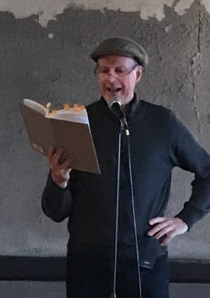 """Activist and former legislator Ed Fallon reads from his book, a memoir about the 2014 """"Great March for Climate Action."""""""