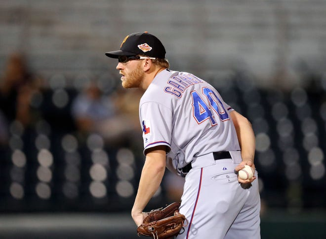 Surprise Saguaros pitcher Reed Garrett of the Texas Rangers during an Arizona Fall League game against the Scottsdale Scorpions at Scottsdale Stadium, Oct. 19, 2016.