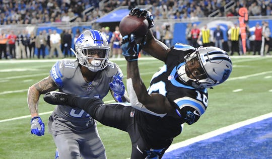 Panthers receiver Curtis Samuel scores a touchdown past Lions cornerback Teez Tabor during the fourth quarter Nov. 18, 2018 at Ford Field in Detroit.