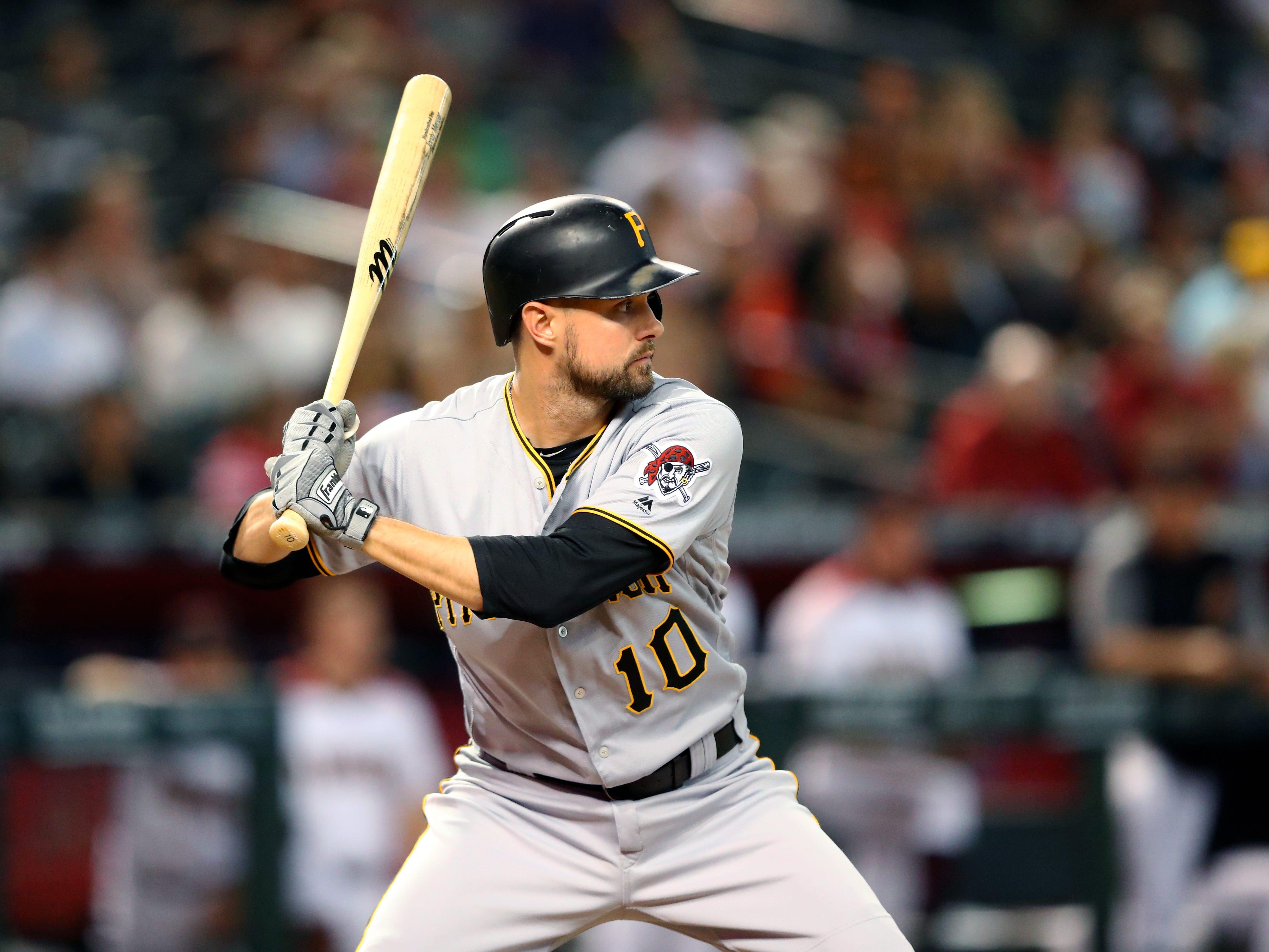 Pittsburgh Pirates shortstop Jordy Mercer bats against the Arizona Diamondbacks at Chase Field, June 13, 2018.