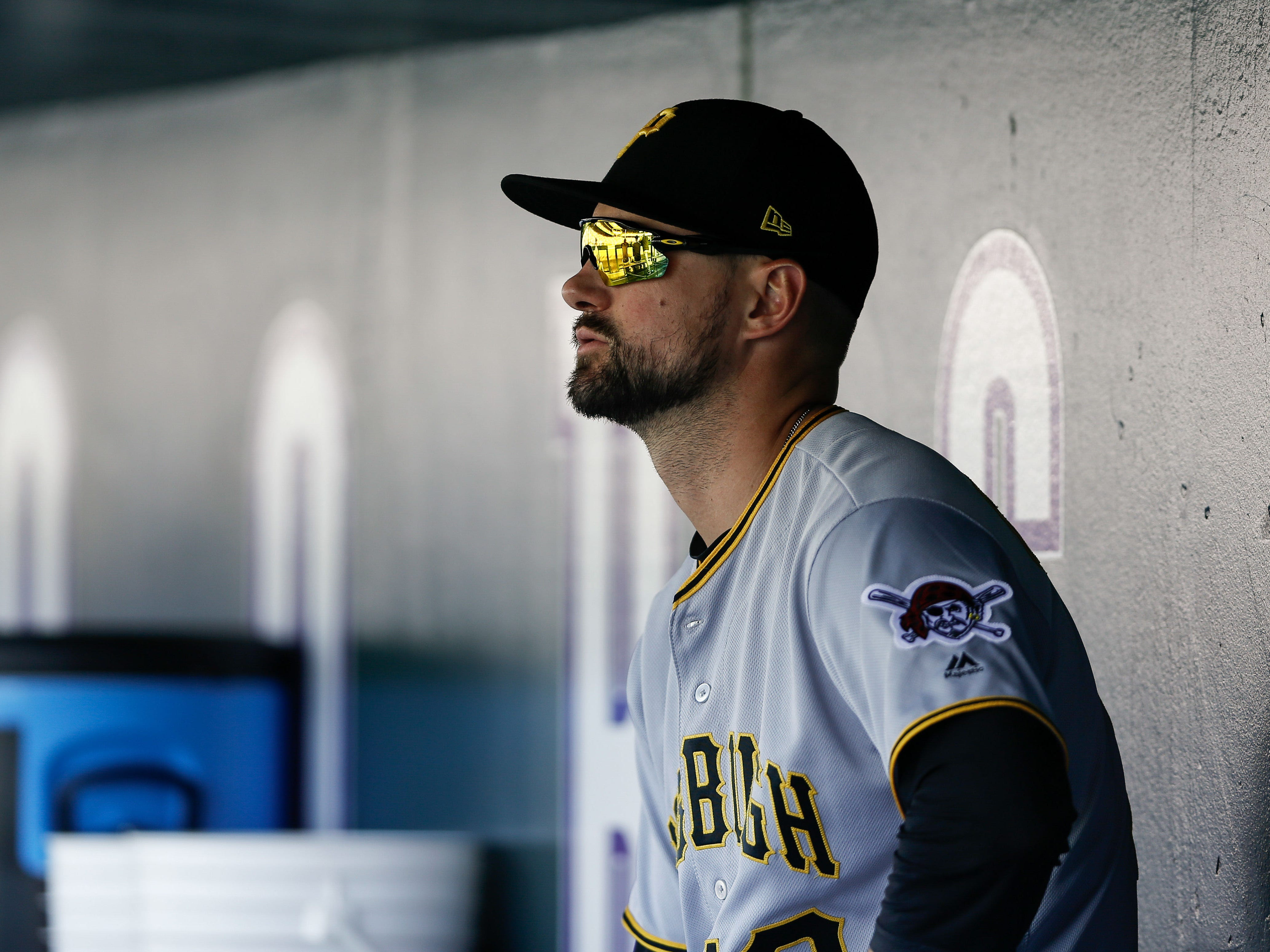 Pittsburgh Pirates shortstop Jordy Mercer in the dugout against the Colorado Rockies at Coors Field, Aug. 8, 2018.