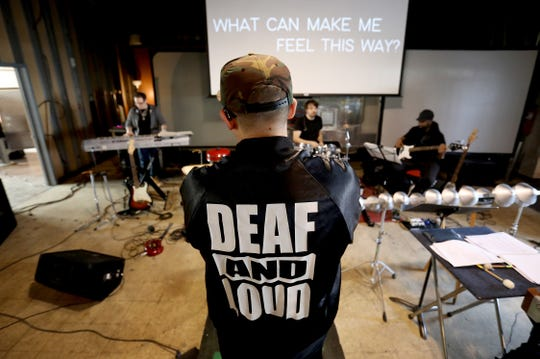 Deaf rapper Sean Forbes performs during rehearsals, for an upcoming performance with the Detroit Symphony Orchestra, at the Deaf Professional Arts Network in Ferndale, Michigan on Wednesday December 12, 2018.