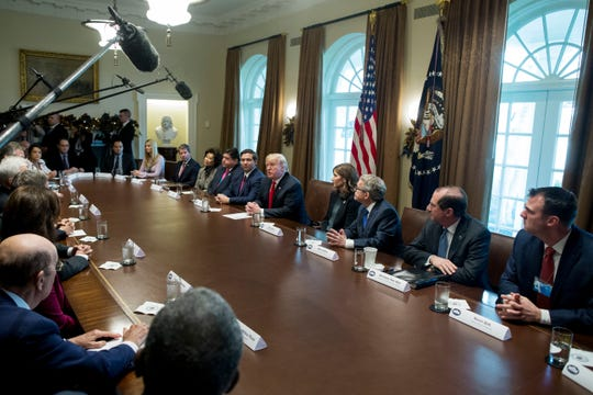 President Donald J. Trump (C) delivers remarks to members of the news media while holding a meeting with governors-elect and members of his administration, in the Cabinet Room of the White House in Washington, DC, on Dec. 13, 2018.