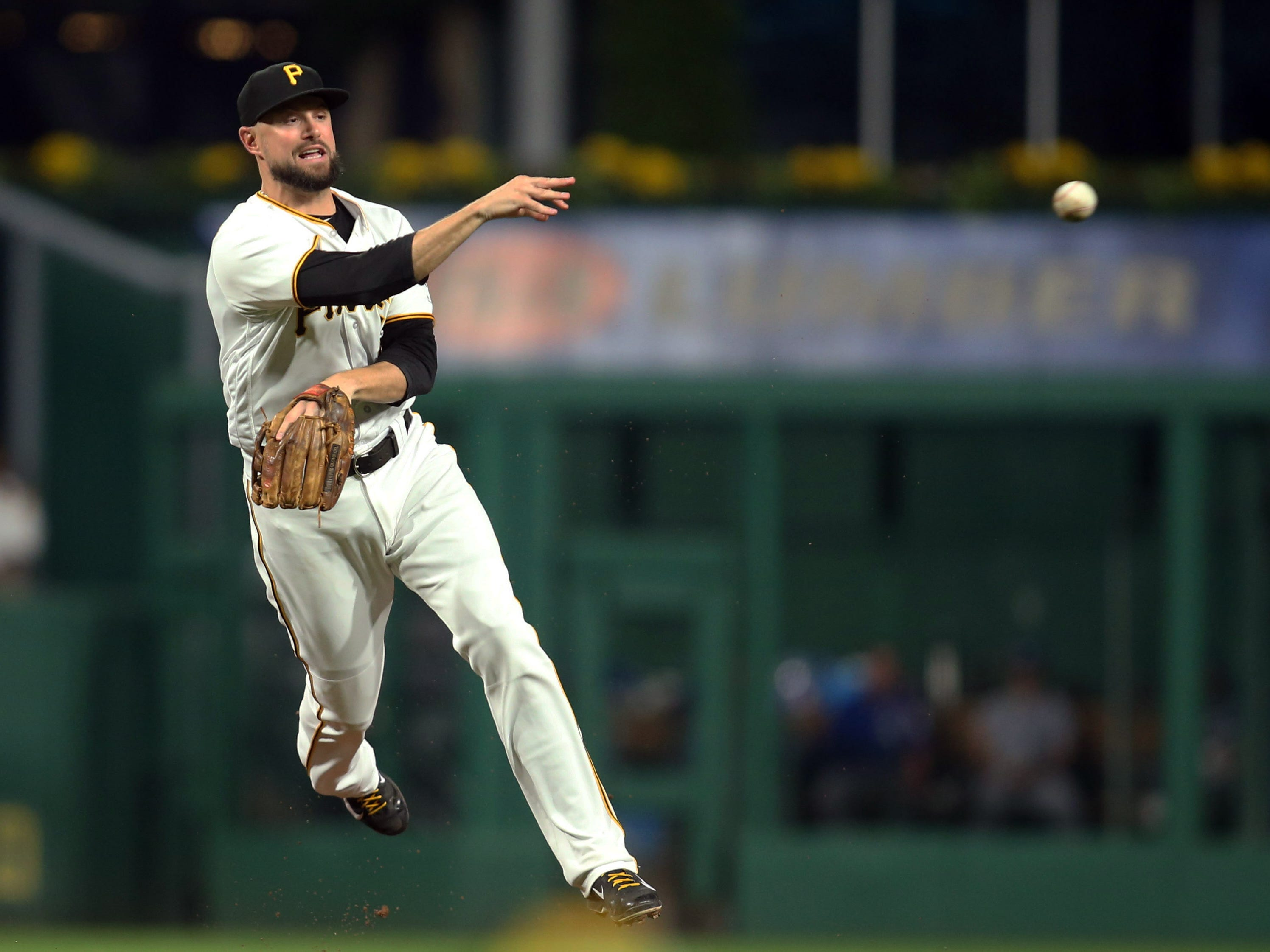 Pittsburgh Pirates shortstop Jordy Mercer throws to first base against the Kansas City Royals during the fourth inning at PNC Park, Sept. 18, 2018.