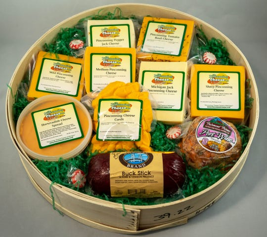 Pinconning Cheese gift box has an assortment of cheeses and sausage.