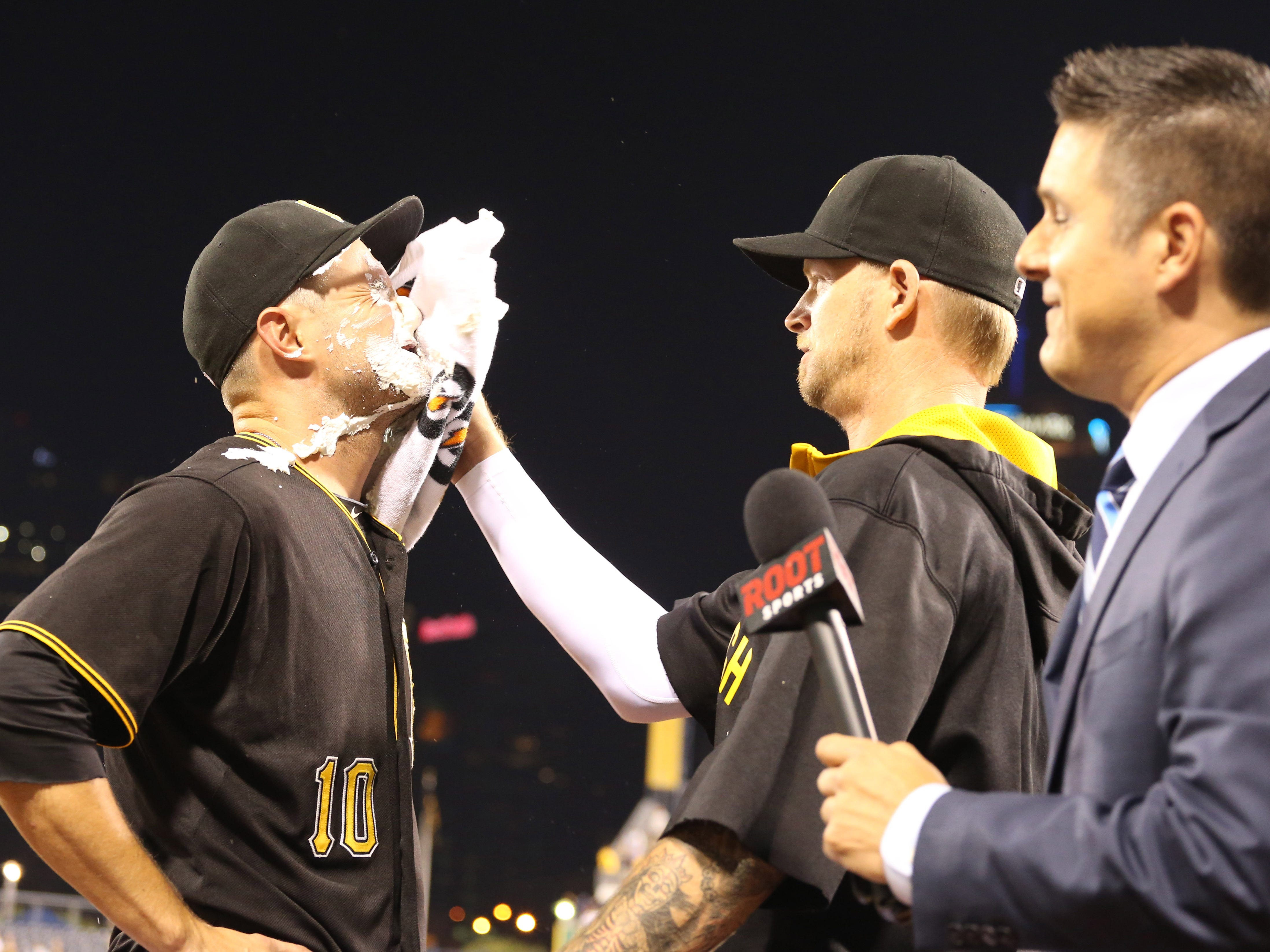 Pittsburgh Pirates shortstop Jordy Mercer is hit with a pie by pitcher A.J. Burnett after Mercer drove in the game winning run against the Atlanta Braves at PNC Park in 2015.