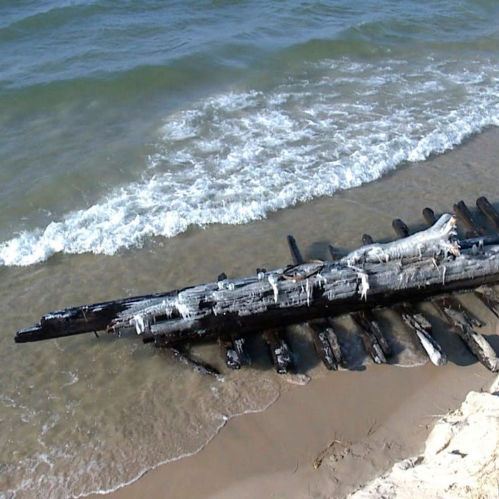 Shipwreck in Lake Michigan revealed after waves, shifting sands
