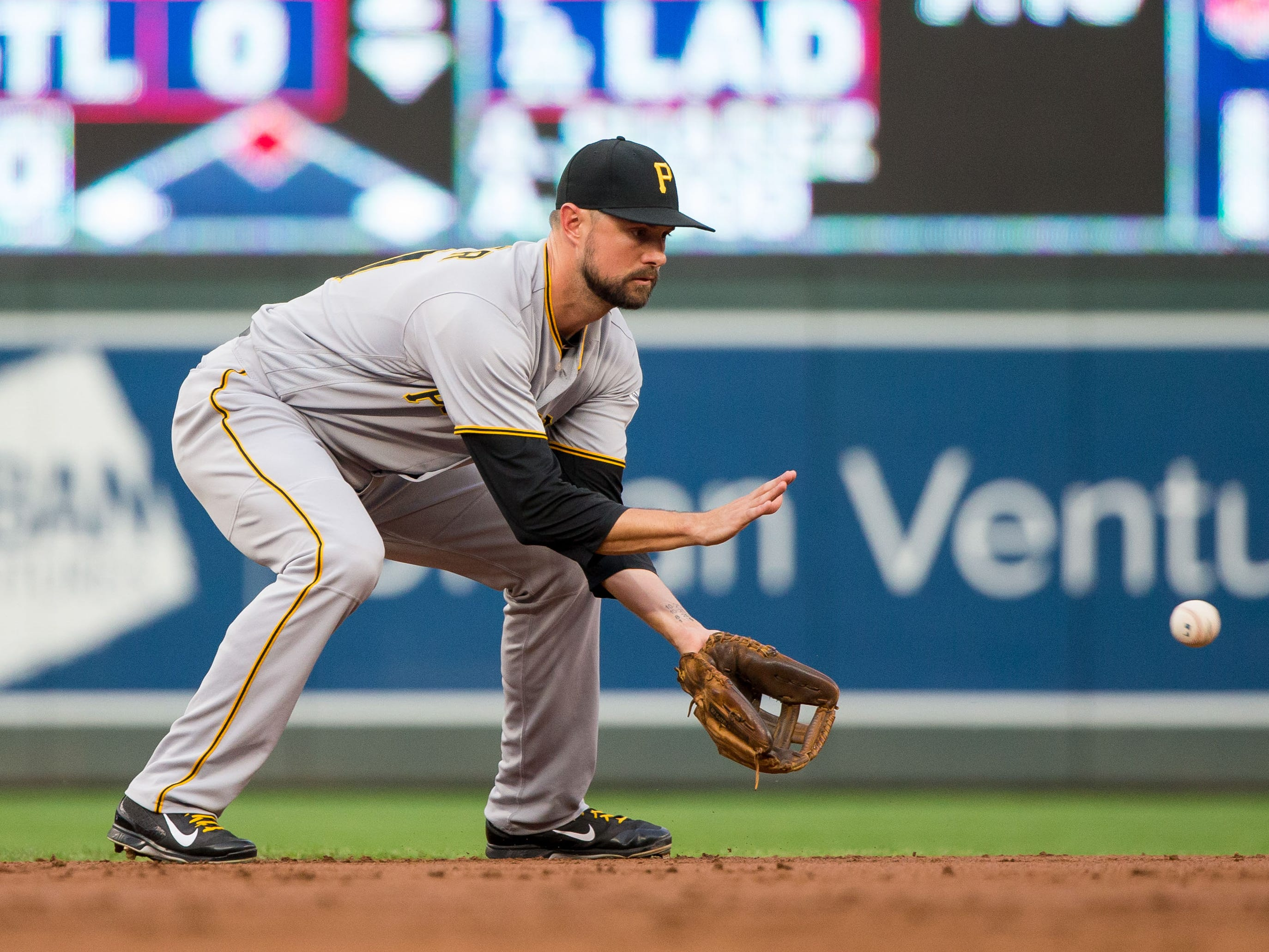 Pittsburgh Pirates shortstop Jordy Mercer fields a ground ball against Minnesota Twins at Target Field, Aug. 14, 2018.
