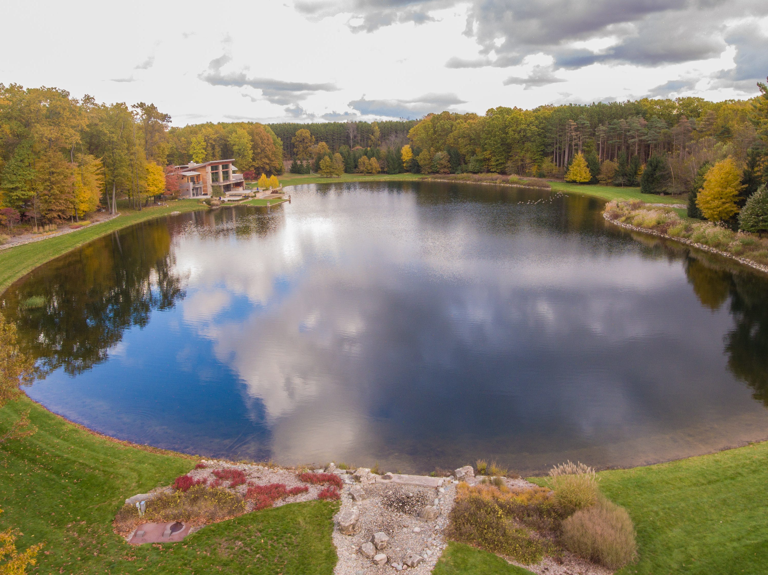 With 28.2 acres of private woods and a five-acre private lake, the secluded paradise is only minutes from downtown Kalamazoo.