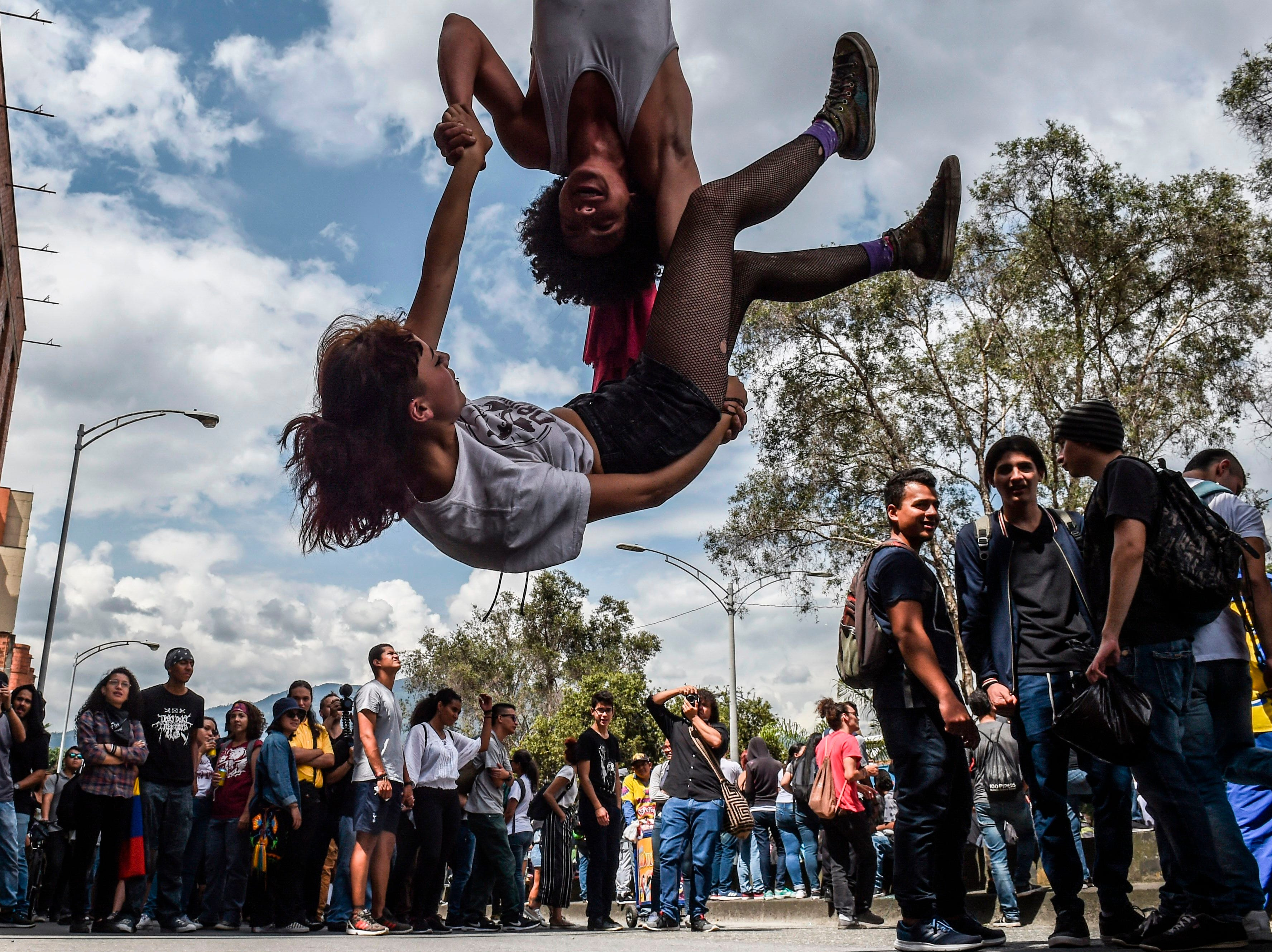 University students protest the crisis in public education, budget cuts and a tax reform project announced by the government of Ivan Duque in Medellin, Colombia, on Dec. 13, 2018.