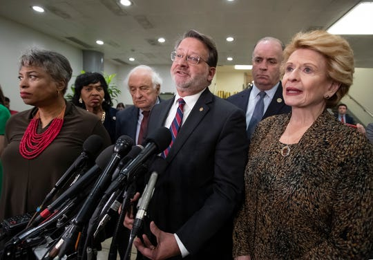 U.S. Sens. Gary Peters, front center, and Debbie Stabenow, right, discussed the coronavirus crisis during a virtual town hall Thursday evening.
