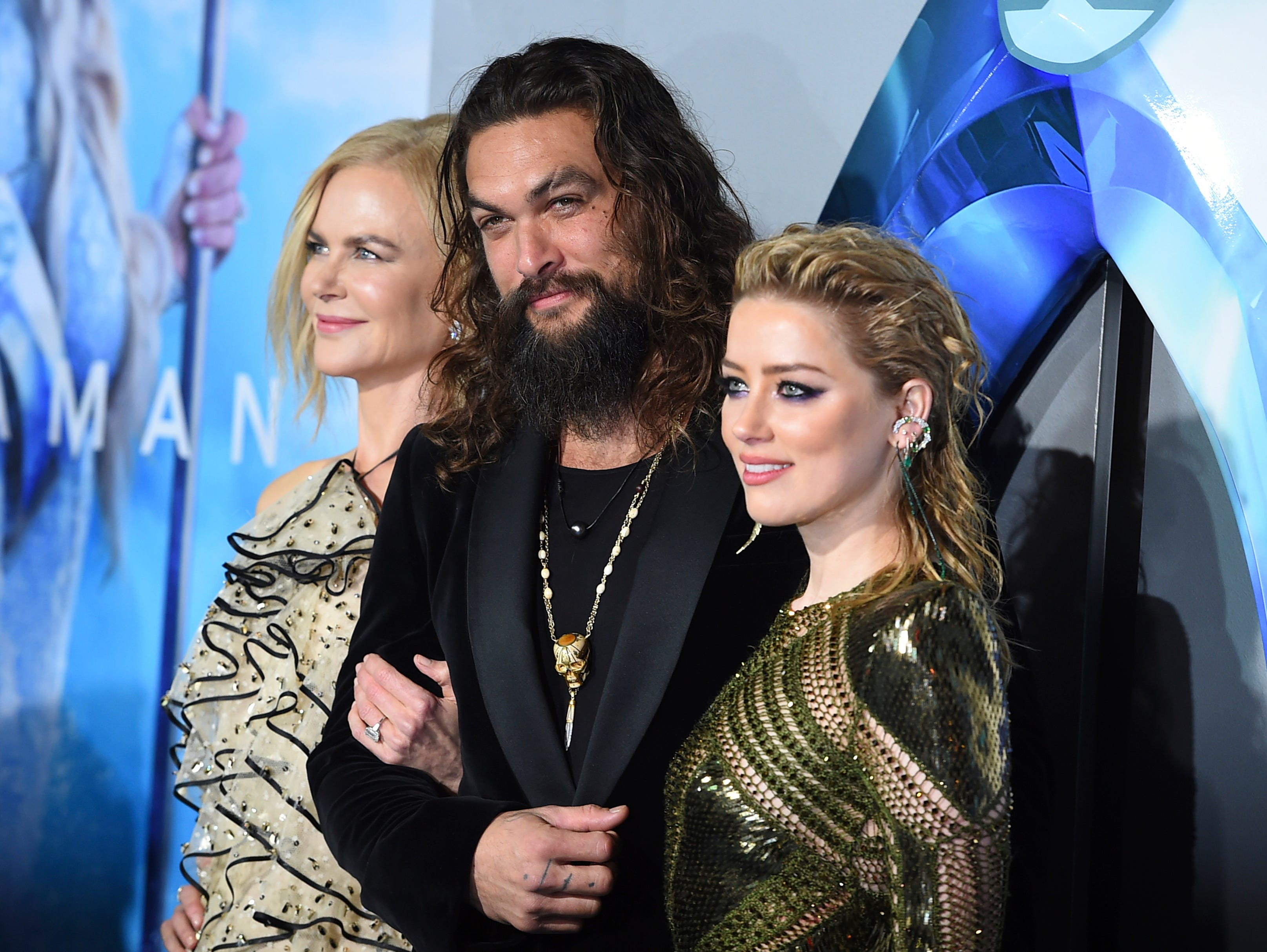 """Nicole Kidman, left, Jason Momoa and Amber Heard arrive at the premiere of """"Aquaman"""" at TCL Chinese Theatre on Wednesday, Dec. 12, 2018, in Los Angeles."""