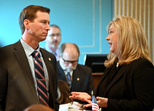"Sen.  Dave Hildenbrand (R-Lowell) talks with Sen. Tanya Schuitmaker (R-Lawton) as the Michigan Senate considers bills during ""lame duck"" session in Lansing on Dec. 12, 2018."