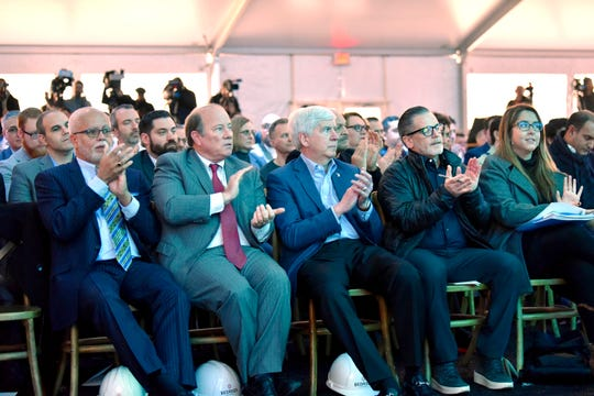 Dignitaries including Wayne County Executive Warren Evans, from left, Detroit Mayor Mike Duggan, Gov. Rick Snyder and Bedrock chairman Dan Gilbert listen to speakers during the groundbreaking ceremony for Bedrock's 1.4 million square-foot Monroe Blocks project.
