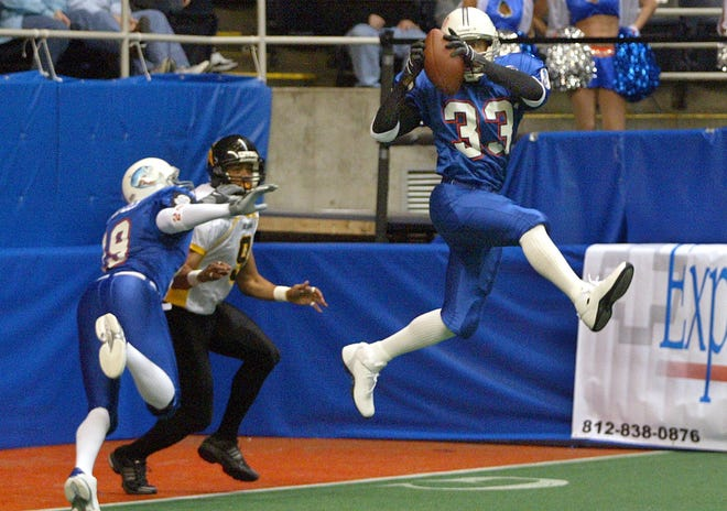jc032903_bluecats.cut JASON CLARK / Courier & Press Bluecats defensive back Shawn Mercer picks off a pass intended for the Drillers Shockmain Davis, near the goalline during the first half at Roberts Stadium on Saturday.   The Evansville Bluecats played their first home game in Evansville Ind., on Saturday March 29, 2003.