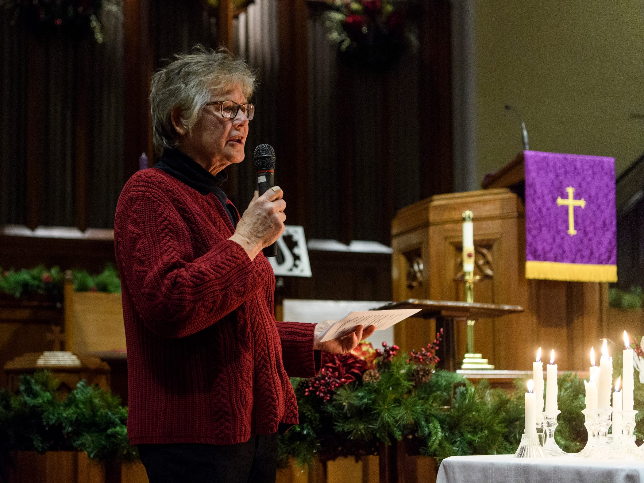 Susan Steinkamp, the program director of Aurora Evansville, addresses the crowd during the 18th annual Homeless Memorial service organized by the non-profit, which serves the area's homeless population, at Trinity United Methodist Church in Evansville, Ind., Tuesday, Dec. 11, 2018.