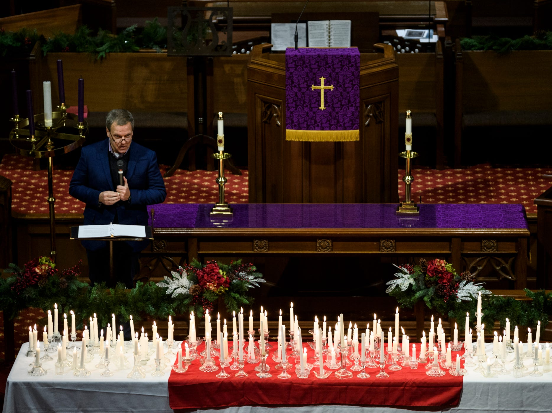 Rev. Scott Cassel of The Turning Pointe United Methodist Church addresses the crowd with a spiritual message during the 18th annual Homeless Memorial service organized by Aurora, a local non-profit serving the homeless population, at Trinity United Methodist Church in Evansville, Ind., Tuesday, Dec. 11, 2018.