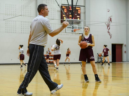 Mt. Vernon's Brooke Jackson (20), right, listens to her father Reed Jackson, left, an assistant coach, give critiques while running drills during basketball practice inside the school's auxiliary gym in Mt. Vernon, Ind., Wednesday afternoon, Dec. 12, 2018. Reed is a former University of Evansville basketball player (1991-1995).