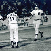 Courtesy Steve PatchinSteve Patchin, right, is congratualted by his Triplett teammates as he comes into home plate following a home run that he hit against the Oklahoma City 89ers at Bosse Field in 1979. Patchin hit two home runs during the AAA game. The Tripletts were the AAA team for the Detroit Tigers and the 89ers were the AAA team for the Phillies.