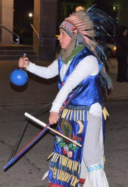 A dancer with a troupe from Willard, Ohio, wears traditional Mexican garb while dancing in Fremont.