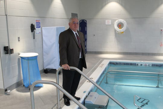 Michael Winthrop, The Bellevue Hospital's president and CEO, stands by the new aquatic therapypool at the Eagle Crest Health Park, which opened this week.