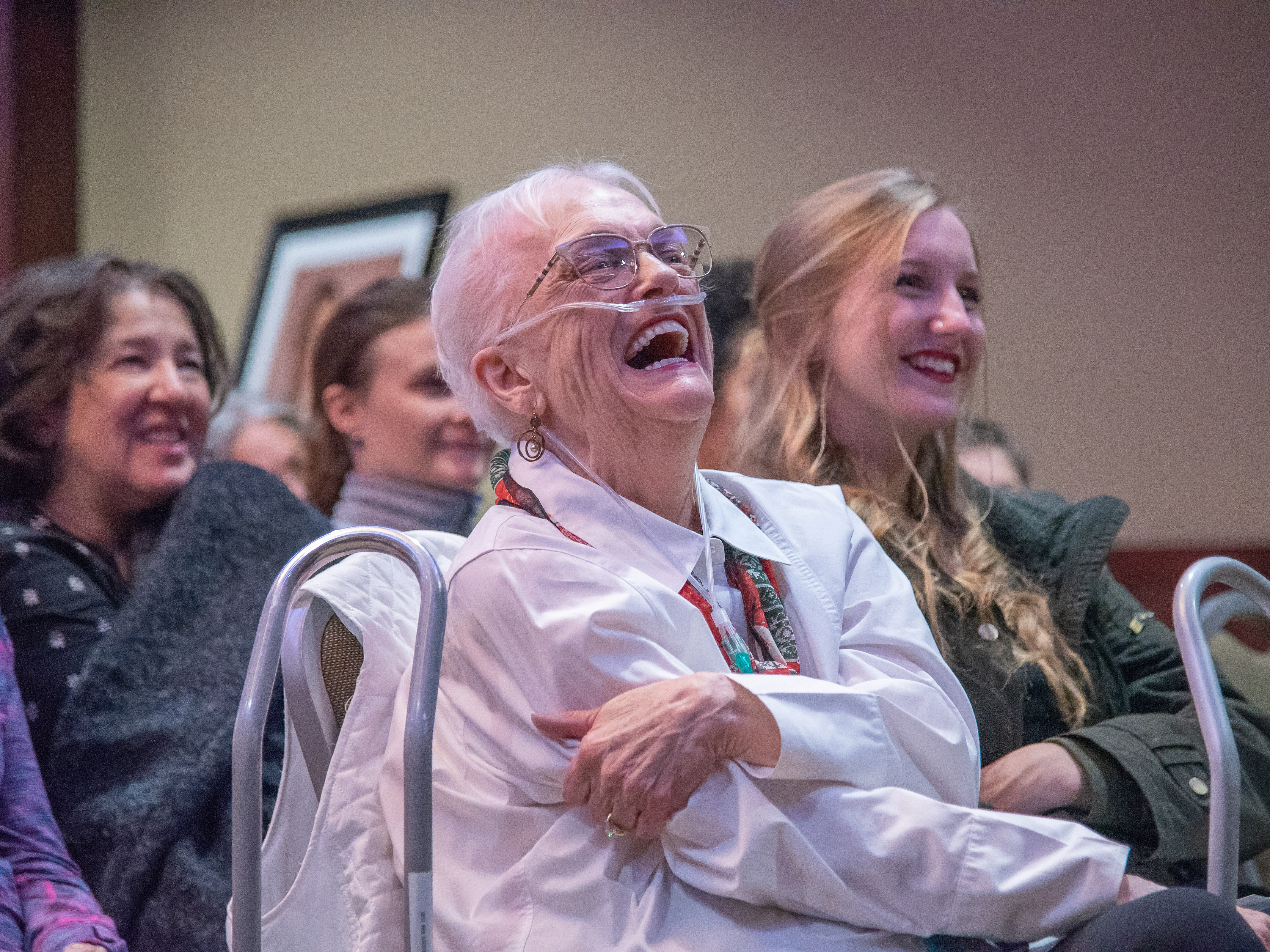 Audience member Patricia Barry reacts to a story told by Tim Dolan during the Coloradoan Storytellers Project at Lincoln Center on Tuesday, December 11, 2018.