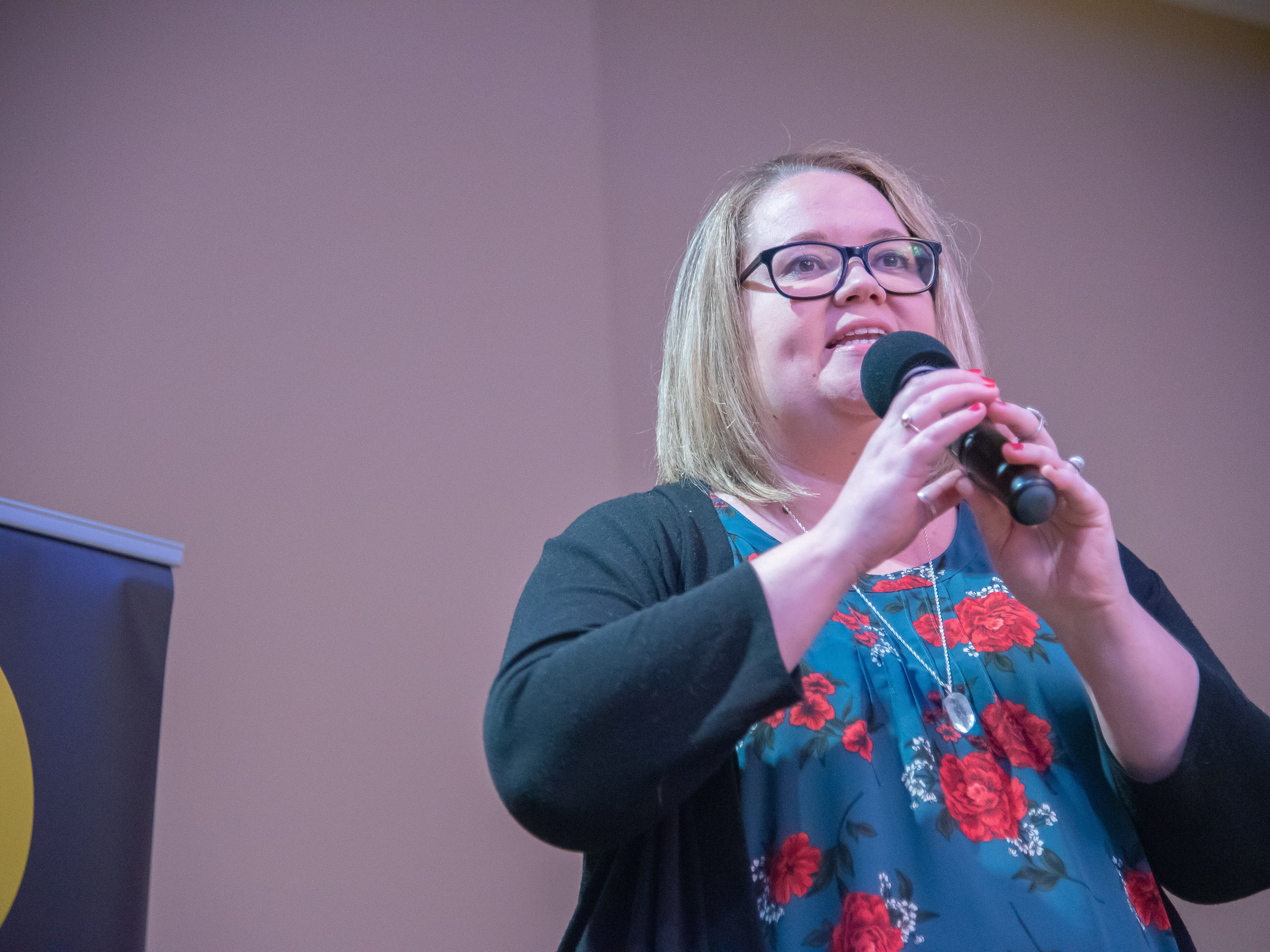 Storyteller Ali Owens tells a story about overcoming obstacles during the Coloradoan Storytellers Project at Lincoln Center on Tuesday, December 11, 2018.