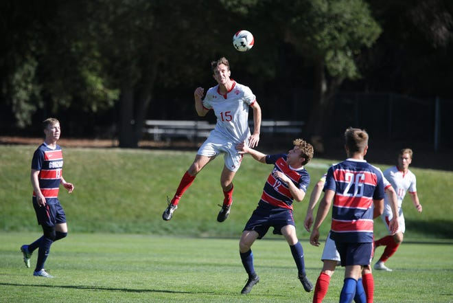St. Mary's Jake Rudel goes for a header during a game this season. The former Fort Collins High School standout led the Gaels to an 18-0-2 record.