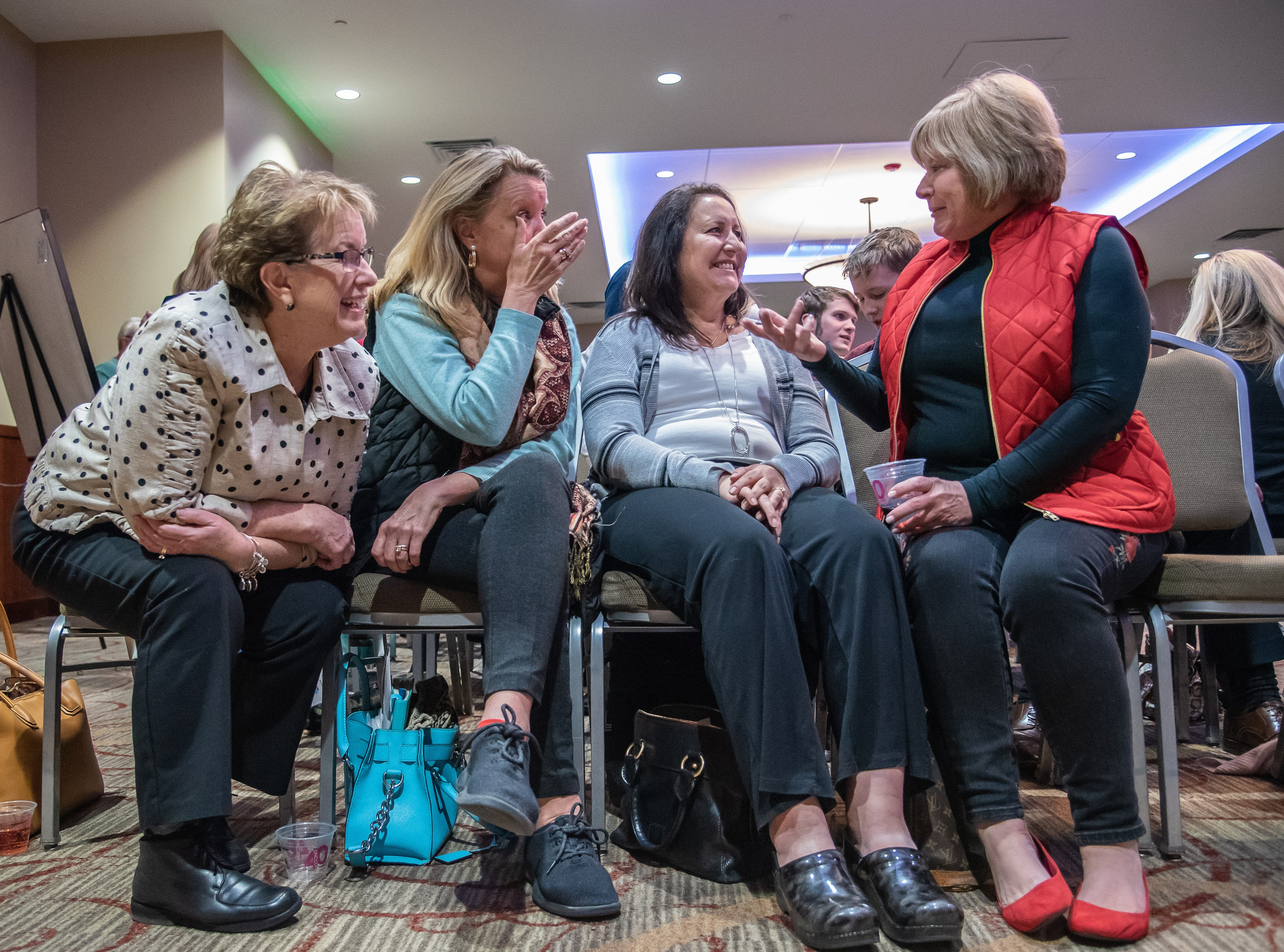 Audience members Peggy Wagner, Julie Ulstrup, Deanna Krausse and Mary Vivo talk during the intermission of the Coloradoan Storytellers Project at Lincoln Center on Tuesday, December 11, 2018.