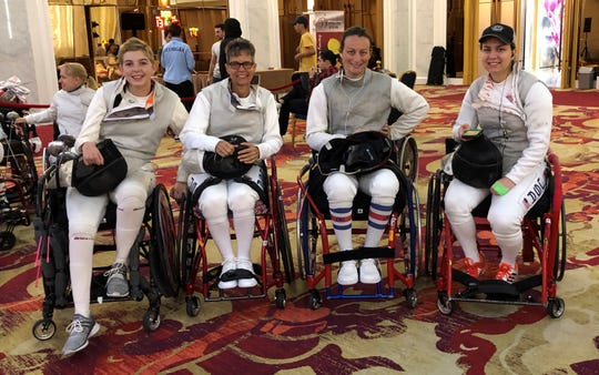 Terry Hayes with other wheelchair fencers.