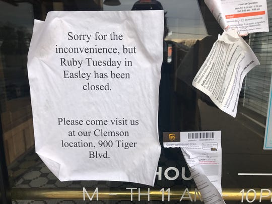 A note on the front door of Ruby Tuesday's in Easley notifies customers that the restaurant has been closed