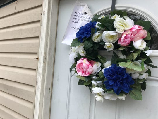 A wreath made by Jacqueline Brown's neighbors hangs on the front door to her mobile home in the wake of losing her four children in a DUI-related vehicle crash Dec. 7.