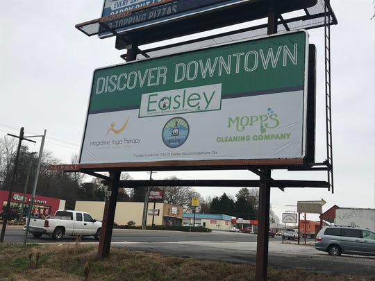 "A billboard along U.S. 123 in Easley encourages passers-by to ""Discover Downtown."""