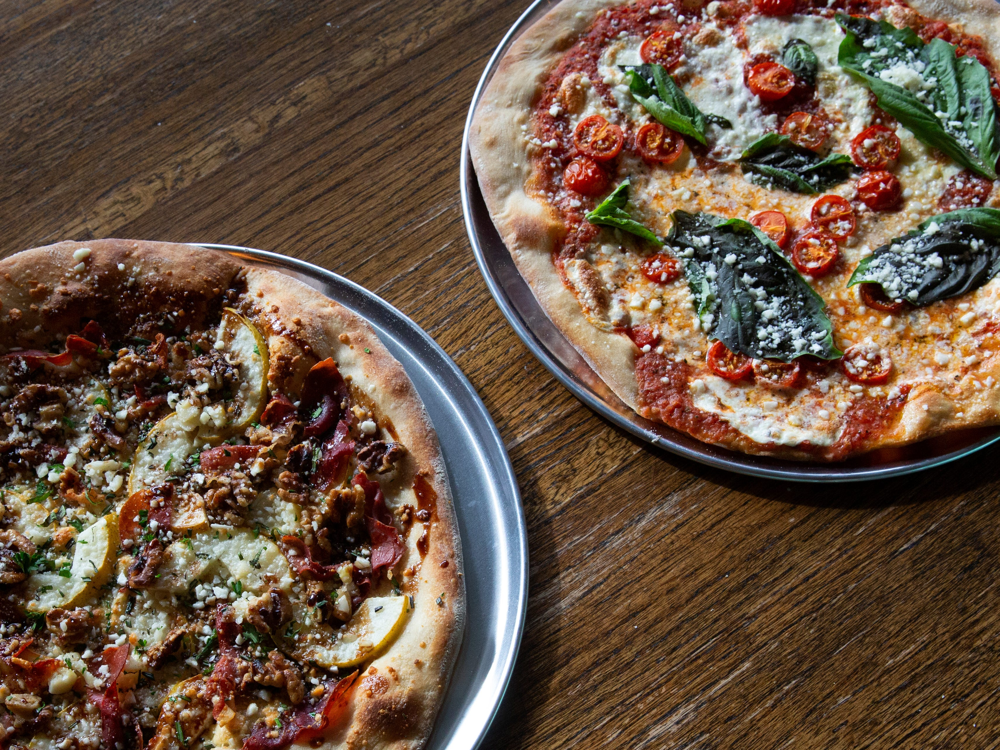 An Italian Pear pizza and an Antique, photographed at Farmhouse Tacos Wednesday, Dec. 12, 2018, are some of the dishes that is planned for Farmhouse Pizza.